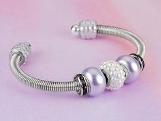 Free Ideas: Artbeads.com - Coiled Elegance; incl. info re: making your own coil