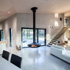 Concrete villa  located in the Spjutsund area along the coast from the Finnish capital. Architects: Mer Architects and Ettala Palomeras Architects