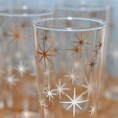 Vintage drink glasses with atomic stars.