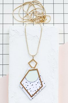 Beautiful long necklace with a geometric pendant, comprised of brass and FORMICA® elements, hanging from a delicate chain, plated with high quality silvery rhodium or 24K gold plating, according to your choice.