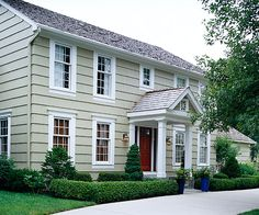 White molding adds classic style to this simple facade. See more ways to update your home: http://www.bhg.com/home-improvement/exteriors/curb-appeal/make-a-better-first-impression/#page=15
