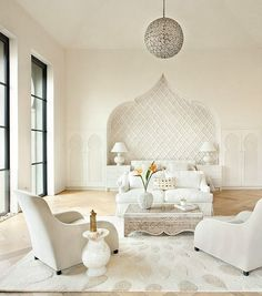 Elegant bedroom in white combines modern and Moroccan influences