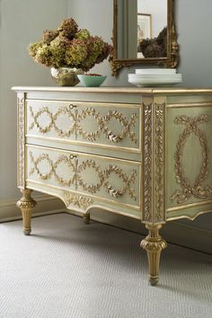 Hand-carved Tuscan style chest with raised laurel garlands finished in antiqued gold leaf, on a hand-painted, antiqued green and ivory background