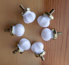 set of 6 matching white glass knobs with brass base $26.75