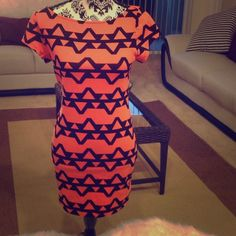 Tribal Print Fitted Dress Fits like a glove. Size large true to size. It stretches. I'm 5'4 and it hits mid thigh-just right. Never worn. Forever 21 Dresses