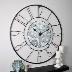 With its oversized black iron frame, the Fulshaw Gears Wall Clock makes the perfect centerpiece for any room. The chic open back design, combined with the gear design in the middle of the clock will give any room an industrial feel. Iron Wall, Wall Clock, Gear Wall Clock, Clock Face, Black Iron, Clock, How To Make Wall Clock, Round Wall Clocks, Metal Clock