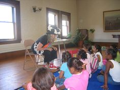 A reading, signing, and rhythmic activity at a Holyoke Public Library children's event.