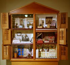 dollhouse in cupboard