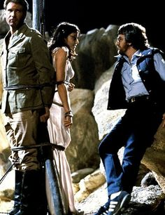 Director Steven Spielberg with Harrison Ford and Karen Allen on the set of…