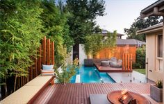 Zen pool designs: Modern zen pool design features Asian bamboo and many inviting outdoor elements for entertaining, such as seating areas and a fire pit. Image: Apex Landscape