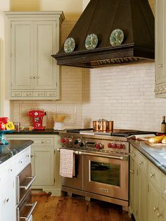 Not sure about the stove in the corner? --stainless steel gas stove range in a kitchen with creamy, subway tiles as the backsplash behind the stove and light, tan kitchen cabinetry to the left and right of it Home Kitchens, Kitchen Remodel, Kitchen Design, Kitchen Inspirations, Kitchen Decor, Painting Kitchen Cabinets, Vintage Kitchen, Kitchen Layout, Corner Stove