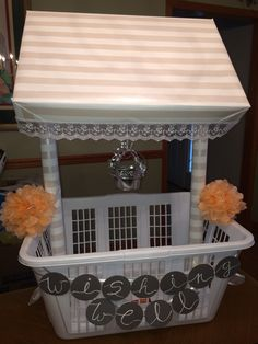 """'Wishing Well' I made for my cousin's shower! - Buy a laundry basket that your bride will use for years to come :) - Wrap two old wrapping paper rolls one time around with your choice of paper - Tie each roll to the side of the basket using ribbon - Wrap a light weight gift box with the same paper  - Using a glue gun, line the box edges with lace - Place the box over top, tucking both poles into the edges - Hang a small """"well"""" bucket with curling ribbon #bridalshower #diy #wishingwell"""
