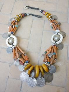 Currency necklace |  Old Silver coins, 'amber' from the African Trade,  shells and oodles of yummy coral! |  Faouzi Designs