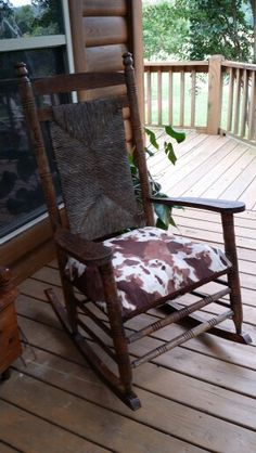 Old rocking chair that i refinished and upholstered on the front porch of our cabin overlooking the river.  www.caddorivercabin.com