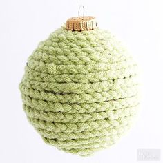 We braided chunky yarn and wrapped it around this ball to hide a dated candy cane design.