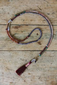 ~ this petite mini mala layering necklace is a continuous circle of THREE tiny 108 gemstone malas each in the traditional zen style configuration. there are sterling silver guru beads placed at the ending/beginning/between each. the gemstones used for each are different, but all three follow this bead count design: 7 tiny beads, 14 tiny gemstones, 66 tiny gemstones, 14 more sandalwood, 7 more tiny beads, all separated by small gemstone markers. the entire necklace ends/begins with one of…