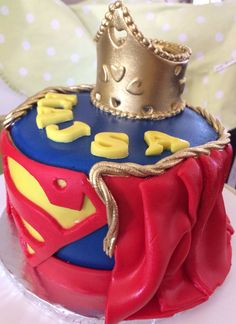 Supergirl themed Birthday cake Cake with a cape Pink and purple