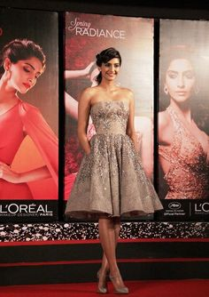 Sonam Kapoor and L'Oreal Paris Cannes 2014 L'Or Lumiere Collection. Indian skin can now also be RADIANT with this new line annnnnnddddd sorry wandering off into thought of HOW BEAUTIFUL SHE PULLS OFF THAT DRESS AS OMG SHE CAN WEAR ANYTHING AND MAKE IT PERFECT LUV HER SOOOOO MUCH <3