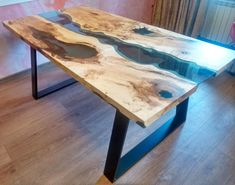 Live edge river table Blue Valley is made out of old solid timber. The tabletop is filled with blue epoxy resin and blue transparent glass.