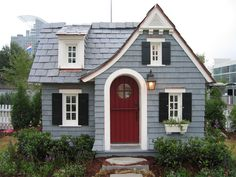muted icy blue siding, deep red door, black shutters and white trim