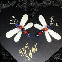 Dragonfly earrings made from.935 silver wire with Carneol and Lapis lazuli stones encased in epoxy resin.