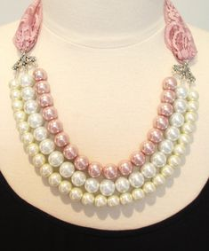 I think I have found the perfect pearl necklace--pink, white, and cream all in one, with lace trim to tie it all together!