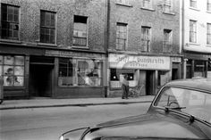 A view of 45-46 North King Street, Dublin city, in 1952 or 1953. Swift Launderette is at number 45 while bootmaker/boot repairer Thomas J McNamee is at number 46. Collection RTÉ Johnson Collection Photographer Johnson, Nevill
