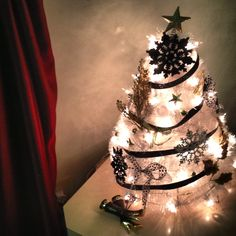 Miniature Christmas, handmade by yours truly. Made with wire hangers & tinsel!