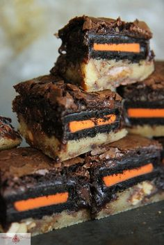 Halloween Slutty Brownies by Heather Christo - Make cookie dough with chopped up twix and milky way midnight and reeses. Use Halloween oreos.