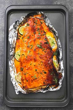 Sweet and spicy, baked honey sriracha lime salmon in foil is tender and flaky and has the most incredible flavors. A healthy and easy 30 minute meal for salmon lovers. | lecremedelacrumb.com