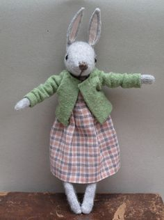 Sweet toy bunny, love her green sweater.