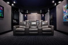 The designers of this space used the cinematic inspiration when choosing the color scheme for the space. The silver material covering the furniture and the walls brings to life the sparkle and glamour of the big screen, while the artwork on each wall incorporates the family's passion for art.