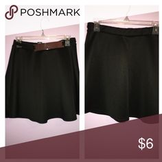 Black mini skirt with gold plate and elastic belt Cute high waist mini skirt with a gold center piece. Stretch material and looks flowy when wearing Rue21 Skirts Mini