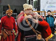 RUSSIA, MOLODI VILLAGE - JULY 27: Unidentified people hug on event dedicated to Victory in battle near the Molodi village 1572, on July 27, 2013, in Moscow region, Russia Батя и два оболтуса-сына