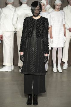 Thom Browne's all black Fall 2015 collection. Get the story on Vogue.com.
