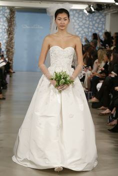 Beautiful satin sweetheart wedding dress from Oscar de la Renta off the Spring 2014 Bridal Runway.