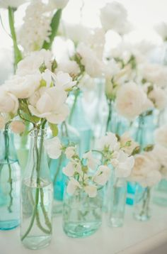 I'm not sure when (or if!) I will ever get tired of colorful glass and beautiful white florals.  #blueglass #simplecenterpieces #whiteflowers