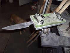 Knife Vise by steve m -- Homemade knife vise constructed from aluminum plate, plastic, a trailer hitch, and quick release skewers. http://www.homemadetools.net/homemade-knife-vise-3