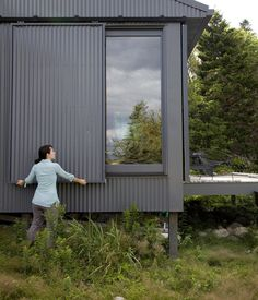 When Alex or Bruce leave the island, closing up shop is as simple as sliding panels of corrugated metal into place to protect the windows.  http://www.dwell.com/green/slideshow/green-cottage-getaway-maine#14
