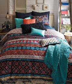 Inspired by the colorful, hand-painted tiles of Mexico City, a bright pattern and patina-textured appearance enliven this dreamy duvet cover.