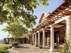 The trellised loggia and bluestone terrace | archdigest.com