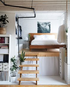 A Toronto couple turned a former cheese factory into their beautiful home. The book-filled loft features clever storage solutions and a…
