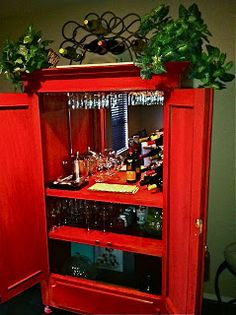 So awesome!  Old armoire into bar!!