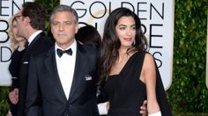 Amal Clooney in Dior, with Harry Winston diamond drop earrings and her own gloves at the 2015 Golden Globes awards.