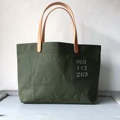 "Tote bag with wax canvas.We called this fabric as ""Kikusui waterproof"""" This wax canvas is used for Truck Tarp. I have stenciled ""003 112 263″  IND_BNP_0263 W 47cm H 27cm D12cm Handle 46cm"