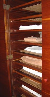 How about really doing it right and have breathable shelves to prevent moisture build up? These shelves are said to be made of rope. This incredible closet is from a Frank Lloyd Wright house.