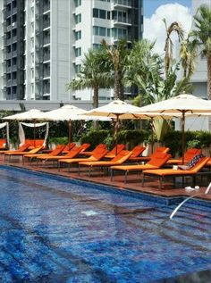 the outdoor pool at the Bangkok Marriott Hotel Sukhumvit ~ These loungers look great for recovering from jet lag. #City