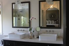Suzie: Greige Design - Gorgeous bathroom remodel with flea market black mirrors with touch of ...