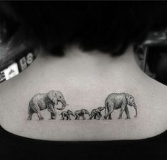 A family tattoo idea. But 4 elephants to represent my dad, mom, brother and I.