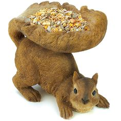 A plump red squirrel shares his bounty with his feathered pals, cupping a generous serving of birdseed in his fluffy tail. Lifelike feeder is a lovable outdoor accent! Polyresin. Birdseed not included
